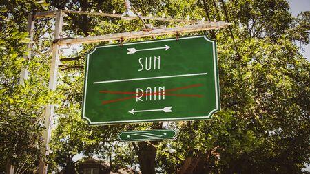 Street Sign the Direction Way to Sun versus Rain Stock fotó - 135498308