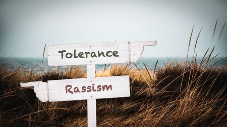 Street Sign the Direction Way to Tolerance versus Rassism Imagens