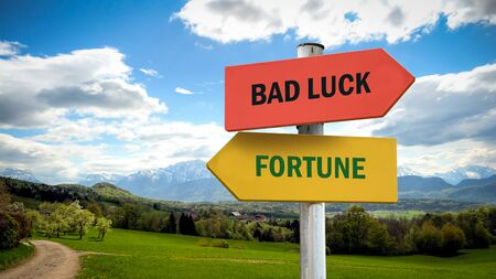 Street Sign the Direction Way to Fortune versus Bad Luck Standard-Bild