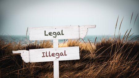 Straßenschild den Weg zu legal versus illegal