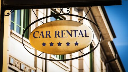 Street Sign the Direction Way to Car Rental Stock Photo
