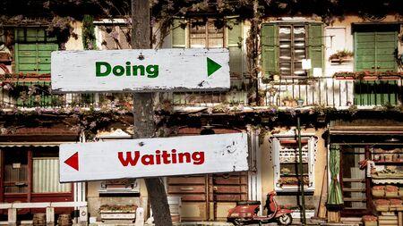Street Sign the Direction Way to Doing versus Waiting Banco de Imagens