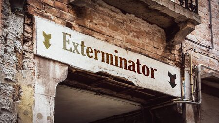 Street Sign the Direction Way to Exterminator Stock Photo