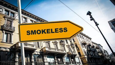 Street Sign the Direction Way to Smokeless Standard-Bild - 140554625