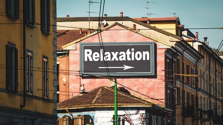 Street Sign the Direction Way to Relaxation Banco de Imagens