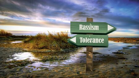 Street Sign the Direction Way to Tolerance versus Rassism