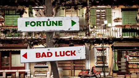 Street Sign the Direction Way to Fortune versus Bad Luck 版權商用圖片