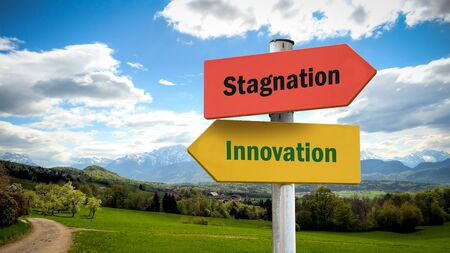 Street Sign the Direction Way to Innovation versus Stagnation 版權商用圖片