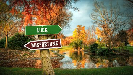 Street Sign the Direction Way to Luck versus Misfortune 免版税图像