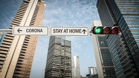 Street Sign the Way to STAY AT HOME Stock Photo