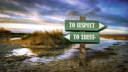 Street Sign the Direction Way TO TRUST versus TO SUSPECT Stock Photo