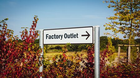 Street Sign the Direction Way to FACTORY OUTLET Stock fotó