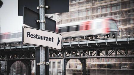 Street Sign the Direction Way to Restaurant Standard-Bild - 147830231
