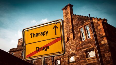 Street Sign the Direction Way to Therapy versus Drugs