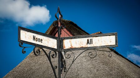 Street Sign the Direction Way to All versus None Stock Photo