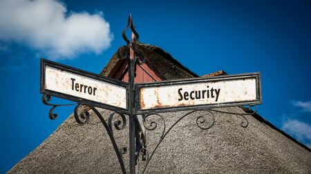 Street Sign the Direction Way to Security versus Terror Standard-Bild