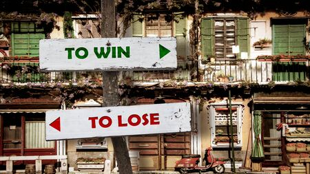 Street Sign the Direction Way TO WIN versus TO LOSE