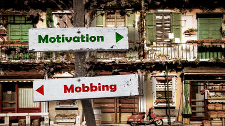 Street Sign the Direction Way to Motivation versus Mobbing Zdjęcie Seryjne