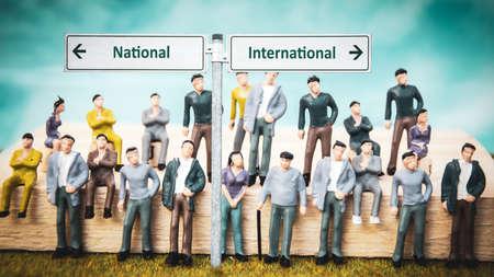 Street Sign the DIrection Way to International versus National Zdjęcie Seryjne