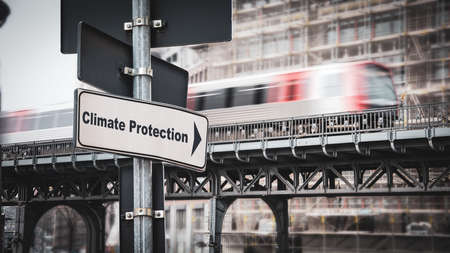 Street Sign the Direction Way to CLIMATE PROTECTION 版權商用圖片 - 151149941