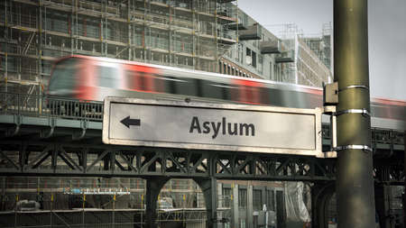 Street Sign the Direction Way to Asylum Stockfoto