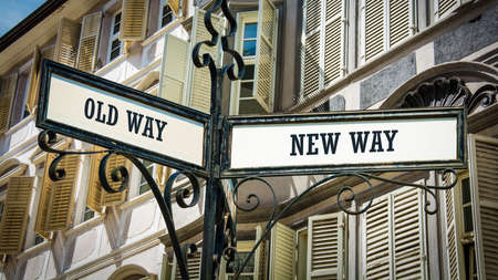 Street Sign the Direction Wy to NEW WAY versus OLD WAY 版權商用圖片