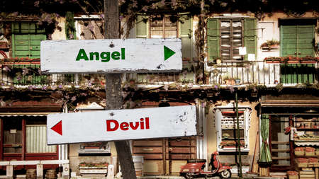 Street Sign the Direction Way to Angel versus Devil
