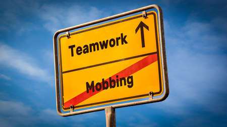 Street Sign the Direction Way to Teamwork versus Bullying