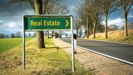 Street Sign the Direction Way to Real Estate Stockfoto