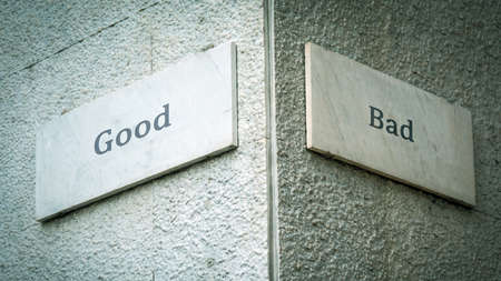 Street Sign the Direction Way to Good versus Bad Stockfoto