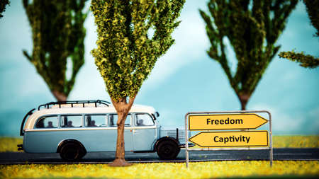 Street Sign the Direction Way to Freedom versus Captivity Stock Photo