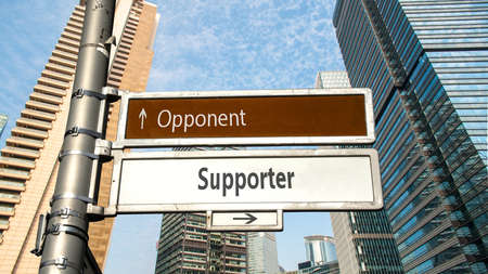 Street Sign the Direction Way to Supporter versus Opponent 스톡 콘텐츠