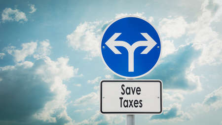 Street Sign the Direction Way to Save Taxes 스톡 콘텐츠