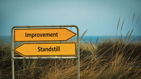 Street Sign the Direction Way to Improvement versus Standstill 스톡 콘텐츠
