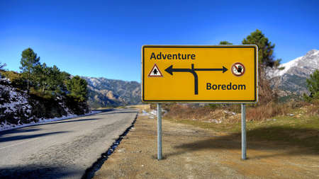 Street Sign the Direction Way to Adventure versus Boredom 스톡 콘텐츠