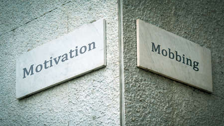 Street Sign the Direction Way to Motivation versus Bullying Imagens