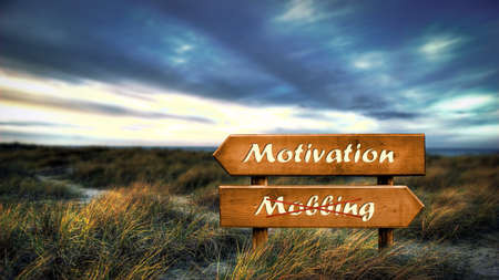 Street Sign the Direction Way to Motivation versus Bullying