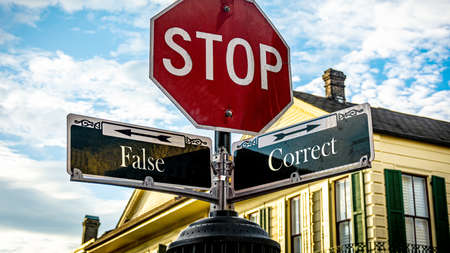 Street Sign the Direction Way to Correct versus False Фото со стока