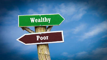 Street Sign the Direction Way to Wealthy versus Poor Banque d'images