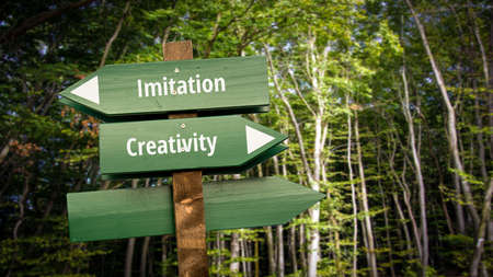 Street Sign the Direction Way to Creativity versus Imitation