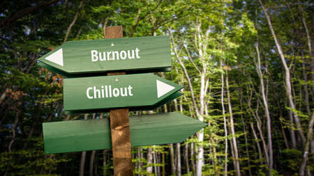 Street Sign the Direction Way to Chillout versus Burnout Archivio Fotografico