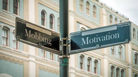 Street Sign the Direction Way to Motivation versus Bullying Stock fotó