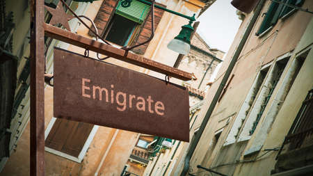 Street Sign the Direction Way to Emigrate Archivio Fotografico