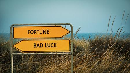 Street Sign the Direction Way to Fortune versus Bad Luck Standard-Bild