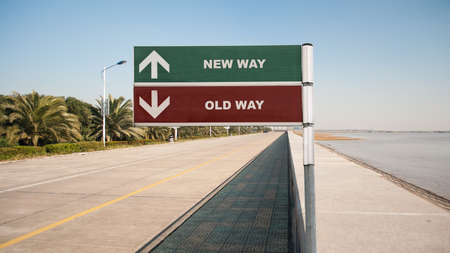 Street Sign the Direction Wy to NEW WAY versus OLD WAY Stock Photo
