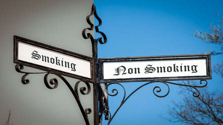 Street Sign the Direction Way to Smoking versus Non Smoking