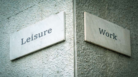 Street Sign the Direction Way to Leisure versus Work
