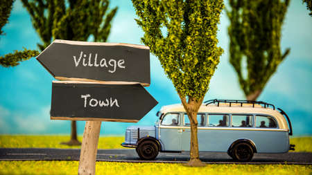 Street Sign the Direction Way to Village versus Town