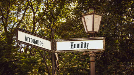 Street Sign the Direction Way to Humility versus Arrogance Archivio Fotografico