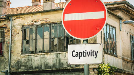 Street Sign the Direction Way to Freedom versus Captivity Archivio Fotografico